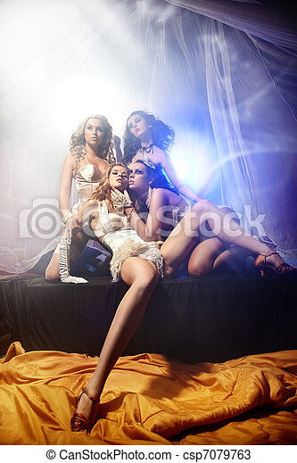 Attractive four ladies posing in sexy lingerie - csp7079763