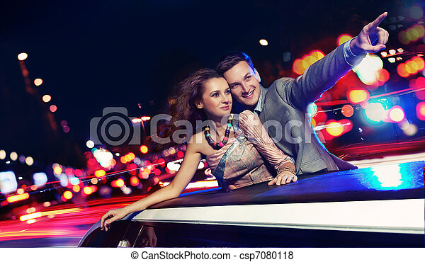 Elegant couple traveling a limousine at night - csp7080118