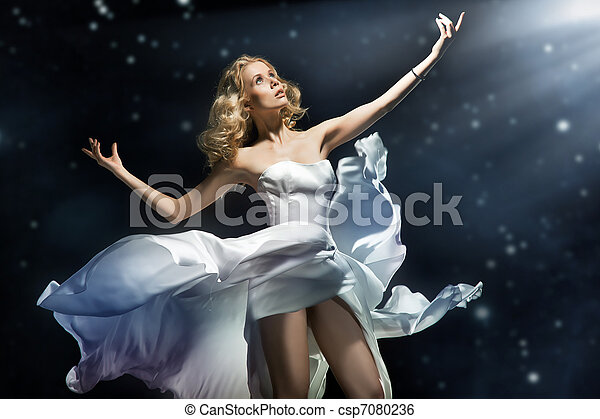 Blonde beauty posing over starry background - csp7080236