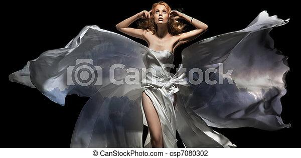 Gorgeous female model wearing white dress - csp7080302