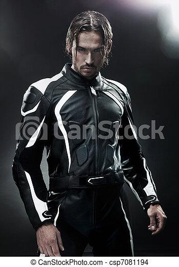 Handsome man wearing motorbike uniform - csp7081194