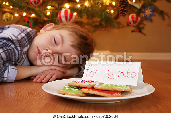 Sleeping boy waiting for Santa - csp7082684
