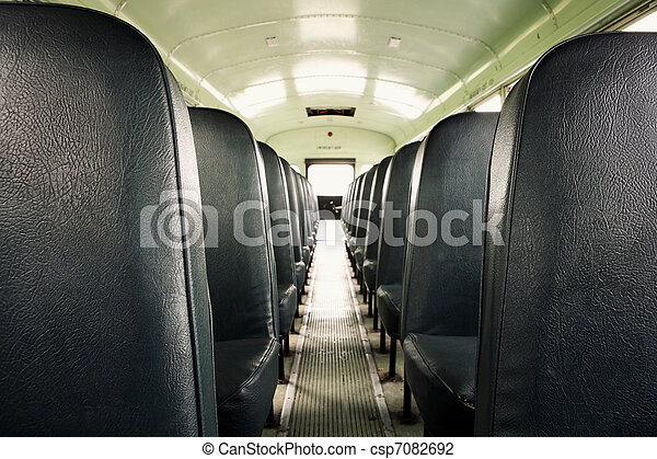 Interior of an old school bus - csp7082692