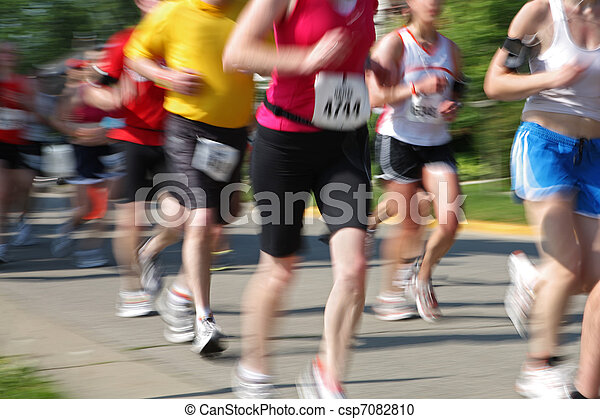 Marathon (in camera motion blur) runners numbers have been chang - csp7082810