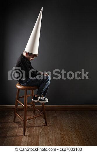Child wearing a dunce cap - csp7083180