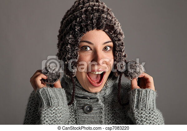 Excited happy young girl in warm winter wool hat - csp7083220