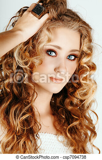 beautiful blond girl with curly hair - csp7094738