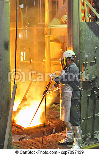 mill worker with hot steel - csp7097439
