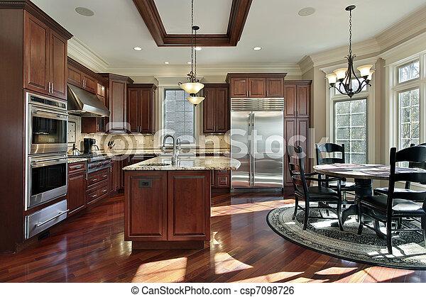 Chestnut Laminate Flooring With Dark Blue Kitchen Cabinets
