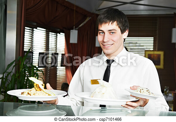 waiter in uniform at restaurant - csp7101466