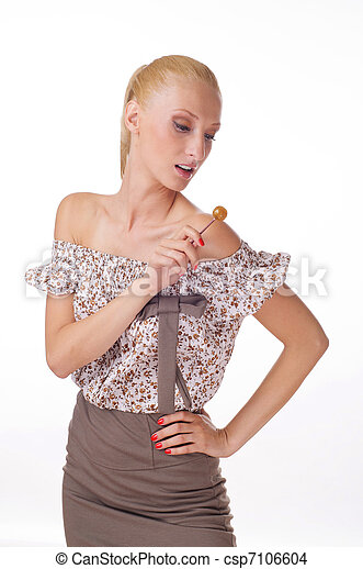 provocative young woman holding lollipop - csp7106604