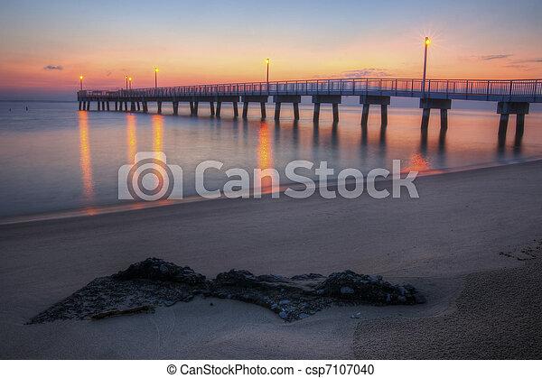 Woodland Beach Fishing Pier Dawn - csp7107040