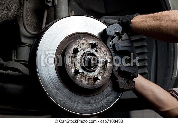 Car mechanic repair brake pads - csp7108433