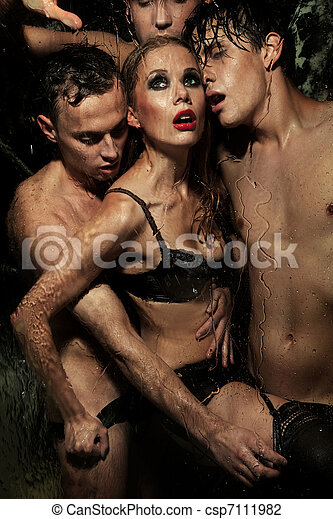 Sexy woman posing with men - csp7111982