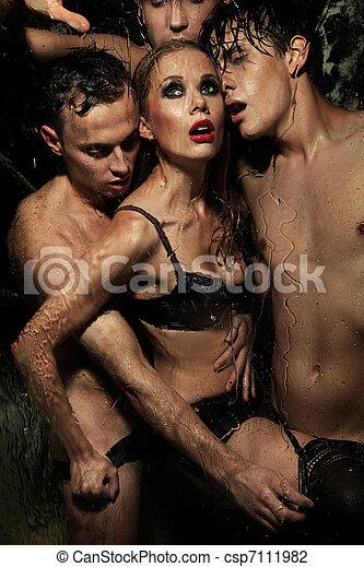 Sexy woman posing with men - csp7111982