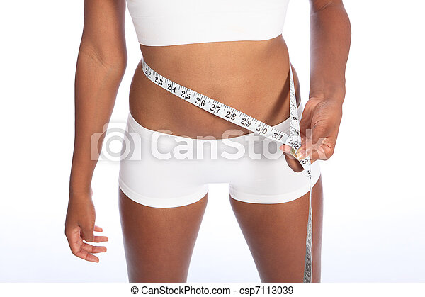 African american woman checking diet weight loss - csp7113039