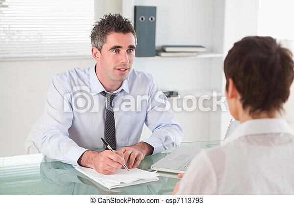 Manager interviewing a candidate - csp7113793