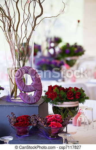 Wedding banquet table with decor and flowers - csp7117827