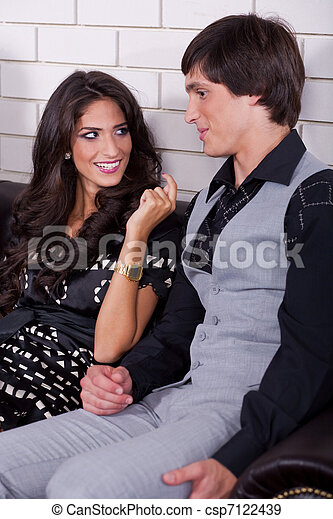 Couple on date in bar or night club - csp7122439