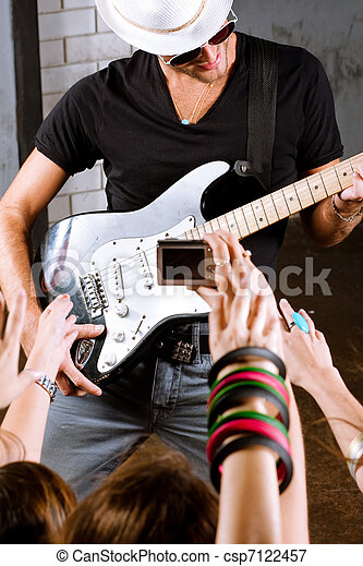 Guitarist playing for is fans