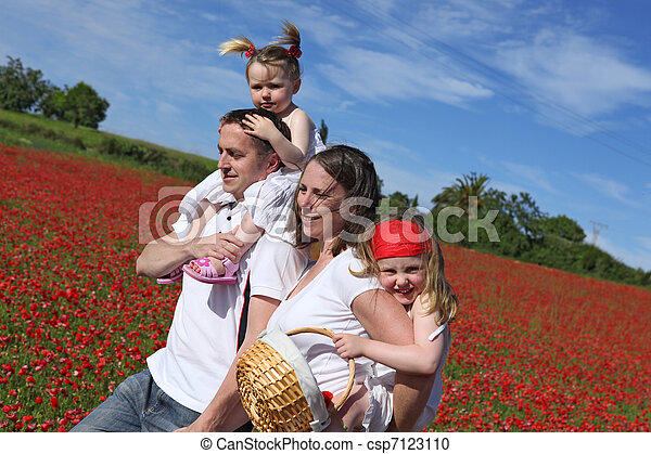 happy healthy family going for walk in countryside - csp7123110