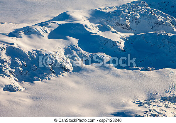 Aerial view of snowcapped peaks in BC, Canada - csp7123248