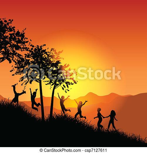 Children running up a grassy hill - csp7127611