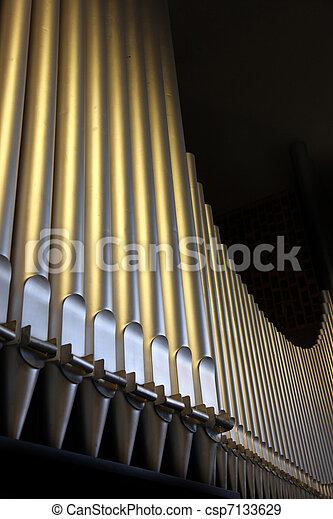 An organ in the church - close-up organ pipes - csp7133629
