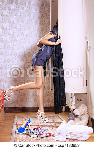 woman near sliding-door wardrobe - csp7133953