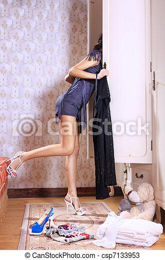 woman near sliding-door wardrobe - csp7133953