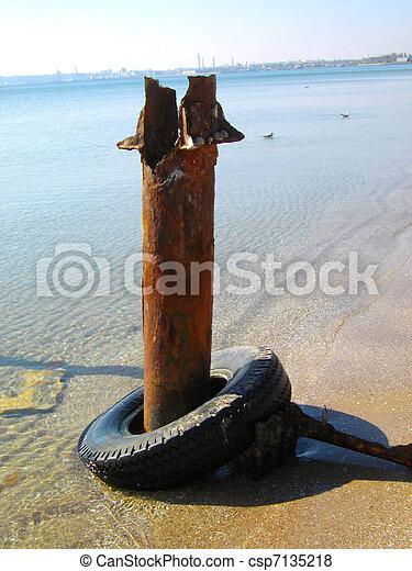 rusty pile on marine moorage - csp7135218