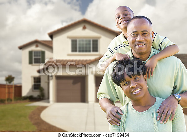 Attractive African American Family in Front of Home - csp7139454