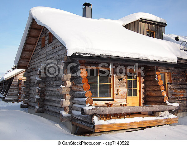 Traditional snow covered log cabin - csp7140522