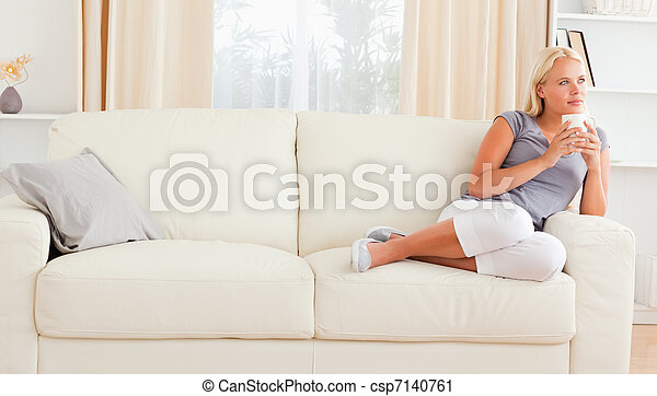 Calm woman holding a cup of tea