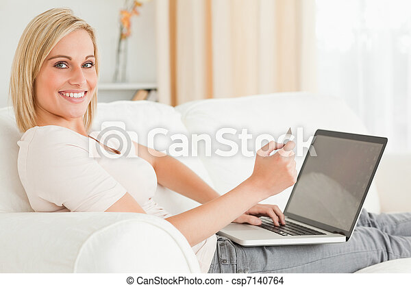 Cute woman paying her bills online - csp7140764