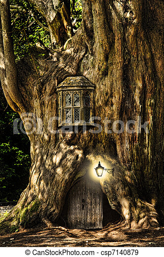 Fantasy fairytale miniature house in tree in forest - csp7140879
