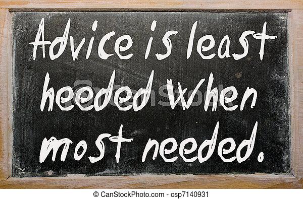 """""""Advice is least heeded when most needed"""" written on a blackboar - csp7140931"""