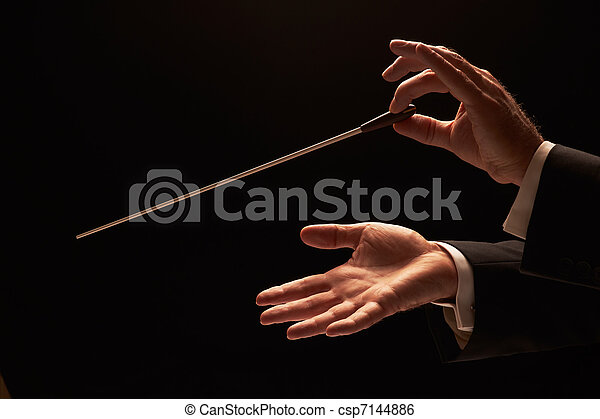 Conductor conducting an orchestra - csp7144886