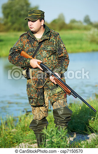 hunter with rifle gun - csp7150570