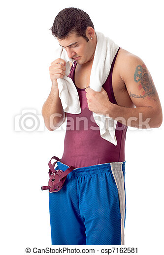 Young adult male wrestler. Studio shot over white. - csp7162581