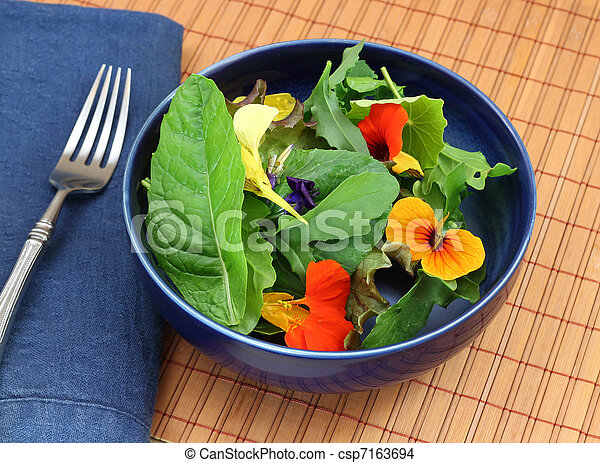 Healthy organic green salad with edible flowers - csp7163694