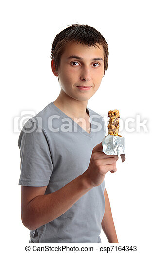 Boy holding a nutritional snack bar - csp7164343