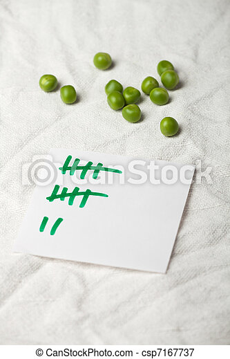 peas and a tally sheet - csp7167737