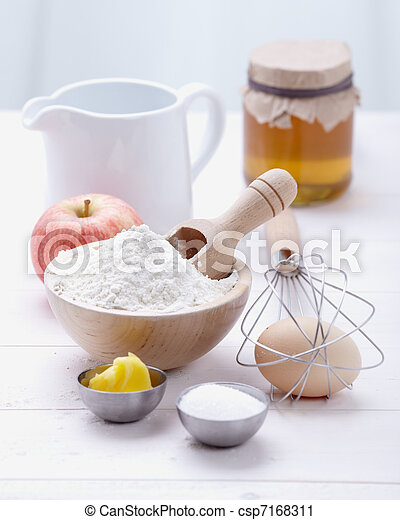 ingredients and tools to make a cake, flour, butter, sugar,eggs - csp7168311