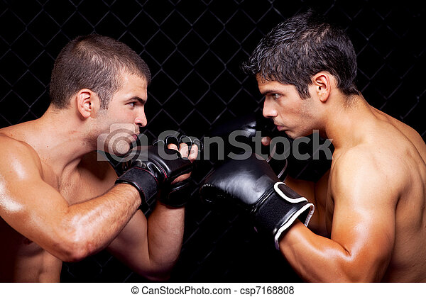 Mixed martial artists before a fight - csp7168808