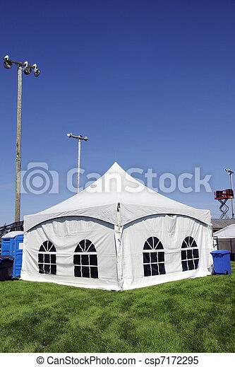 White tent on grass vertical - csp7172295