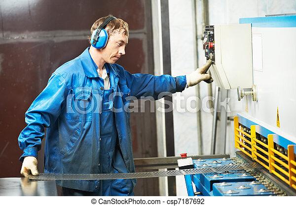 worker operating guillotine shears machine - csp7187692