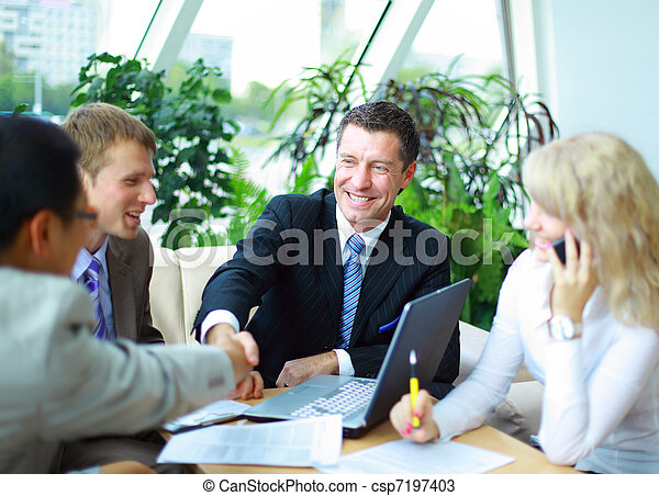 Business people shaking hands, finishing up a meeting  - csp7197403