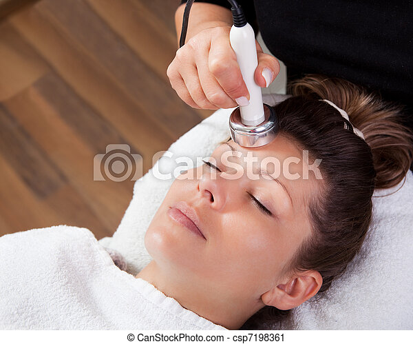 Young woman receiving laser therapy - csp7198361
