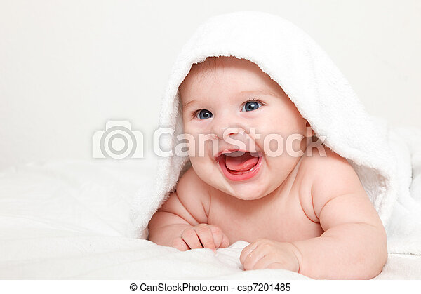 Laughing baby with towel - csp7201485